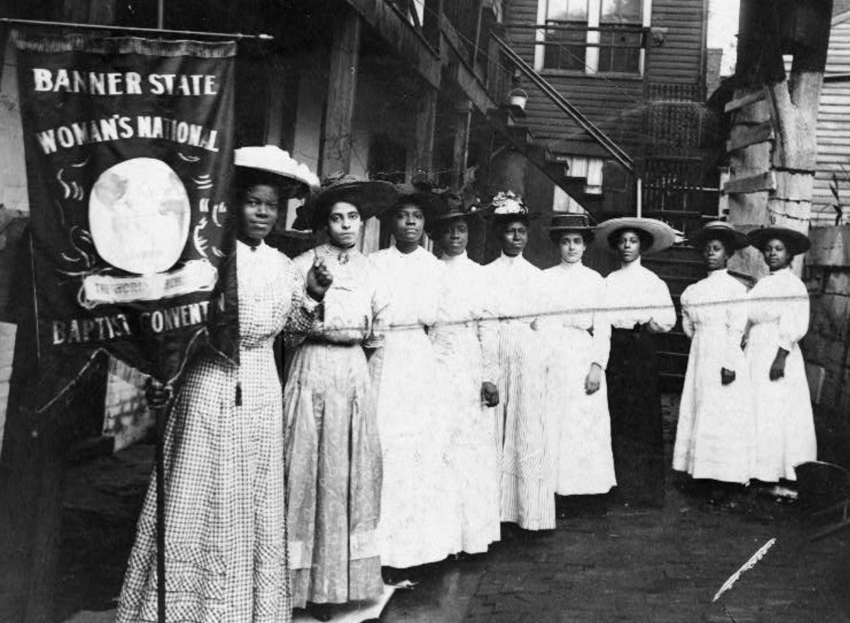 Nannie Helen Burroughs (left, holding banner), a national leader of the Woman's Convention of the National Baptist Convention